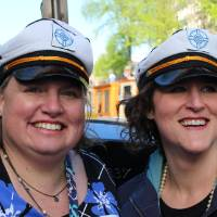 two women smile on boat tour